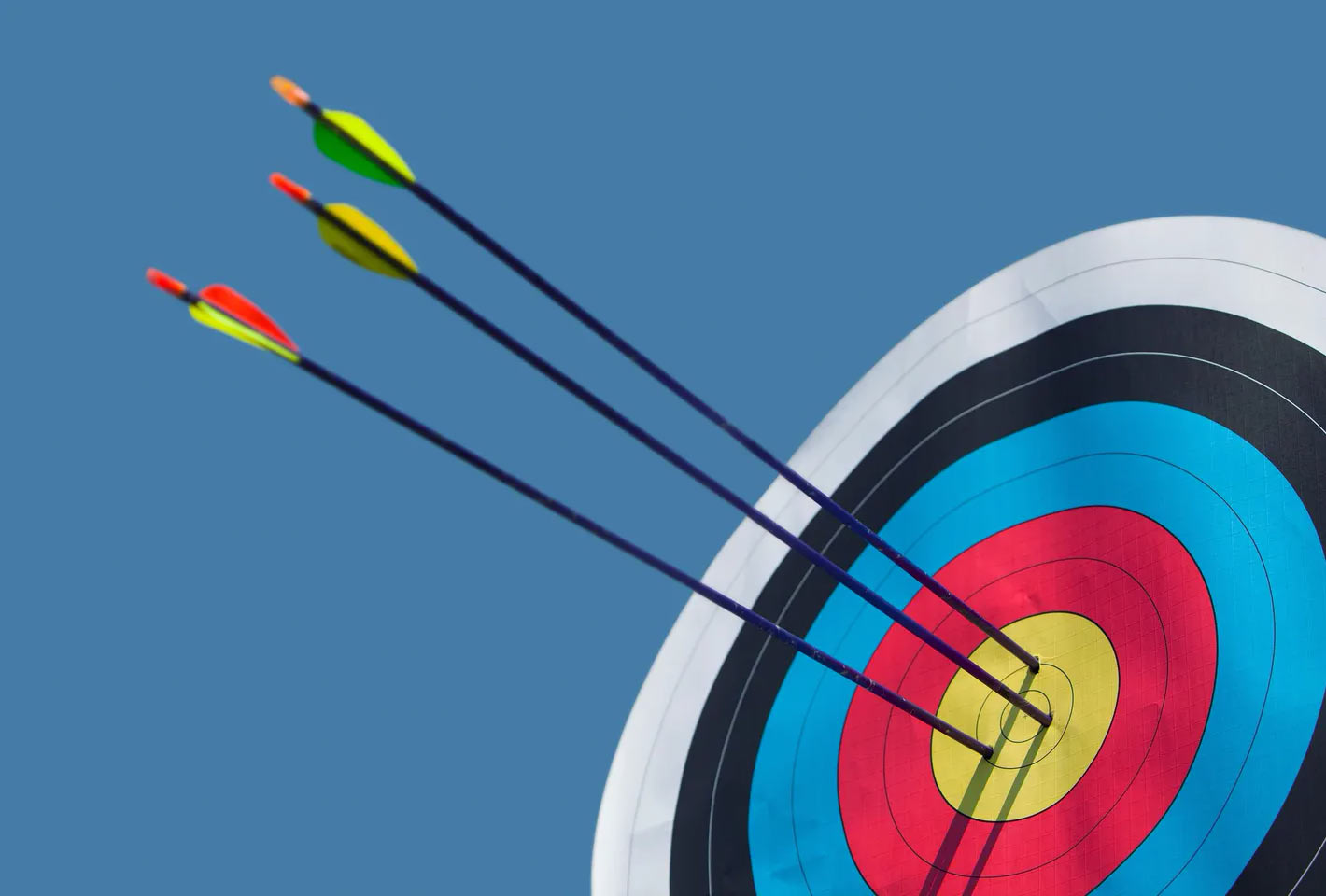 Archery target with arrows in it at Orlando Archery Academy's indoor range in Orlando Florida